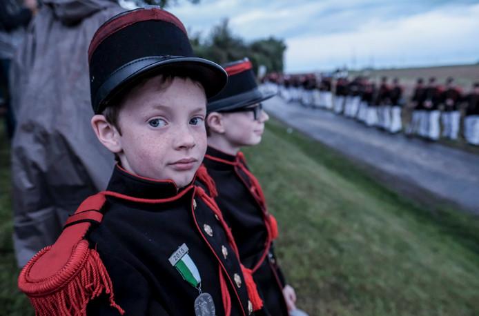 Op pinkstermaandag wordt in het Belgische Gerpinnes de folkloristische mars ter ere van de Heilige Rolende gehouden. Foto Olivier Hoslet