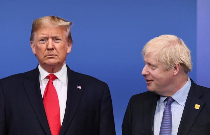 De Amerikaanse president Donald Trump (links) en de Britse premier Boris Johnson tijdens een ontmoeting in Londen in december vorig jaar.
