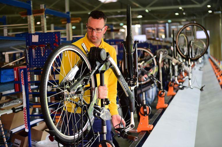 Het kabinet kwam met de leaseregeling om duurzaam vervoer te stimuleren. Beeld AFP/Emmanuel Dunand