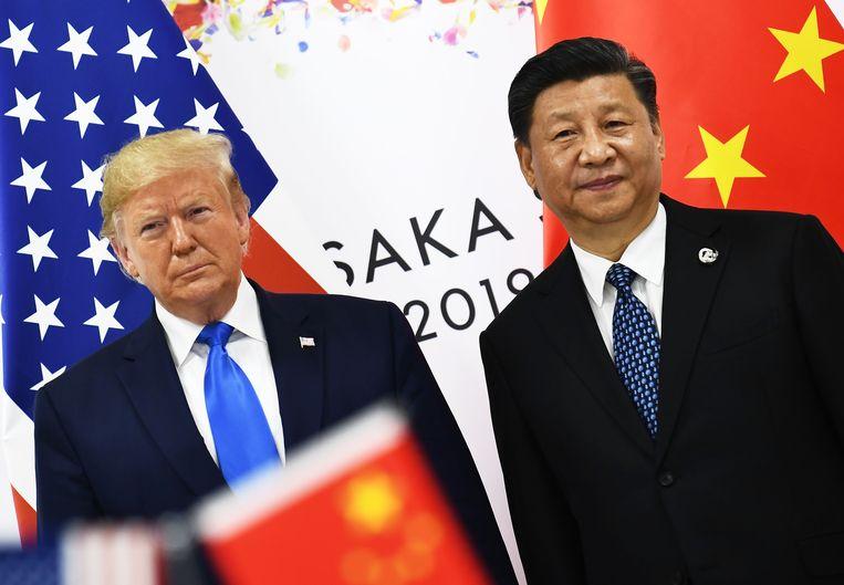 President van de Verenigde Staten Donald Trump (L) en president van China Xi Jinping. Beeld AFP