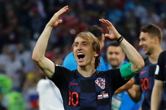 De Kroatische aanvoerder en sterspeler Luka Modric viert de overwinning op Rusland.