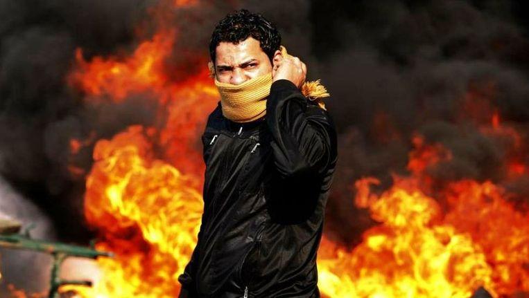 Een demonstrant in Caïro. ©Reuters Beeld