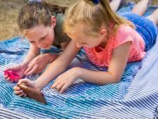 Kinderen moeten in de vakantie juist wél achter de iPad