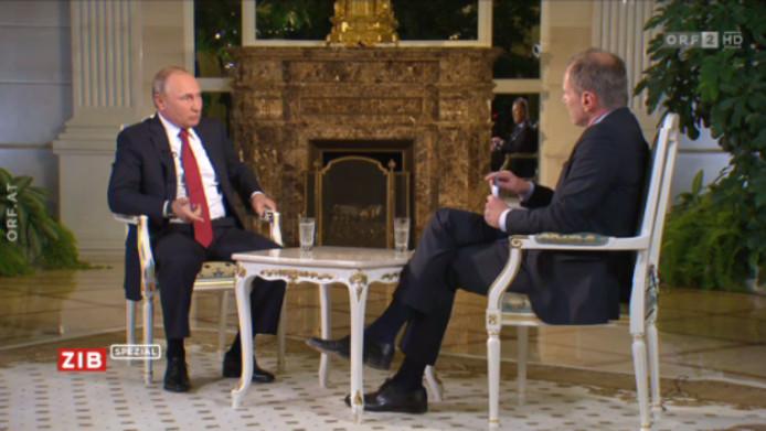 De Russische president Vladimir Poetin tijdens het interview met Armin Wolf op de Oostenrijkse televisie.