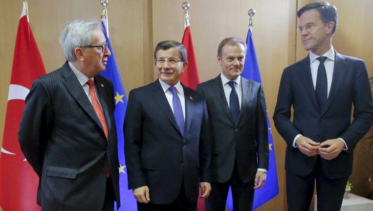 Juncker, Davutoglu, Tusk en Rutte. Beeld reuters