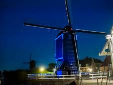 Heusdense molen kleurt blauw voor verjaardag VN