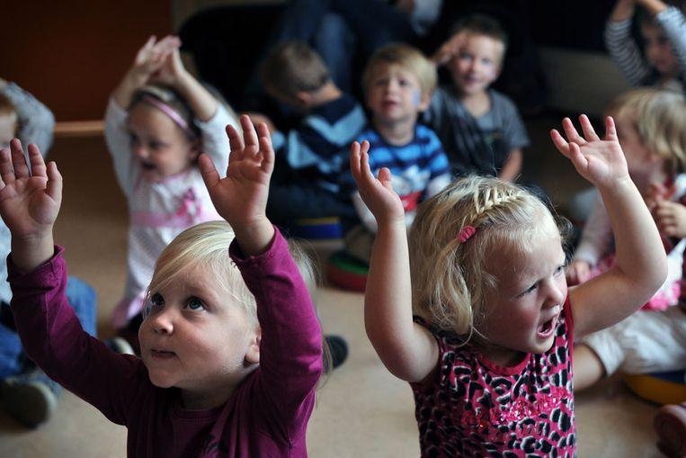 Kinderen op een kinderdagverblijf (Marcel van den Bergh / de Volkskrant) Beeld