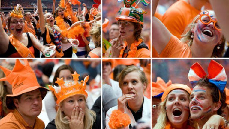 Spanning en ontlading op de gezichten van supporters die in de Amsterdam ArenA de in Zuid-Afrika gespeelde WK-wedstrijd volgen tussen Nederland en Japan. In Amsterdam konden voetbalfans in de RAI en in de ArenA op megaschermen naar de wedstrijd kijken. Foto ANP Beeld