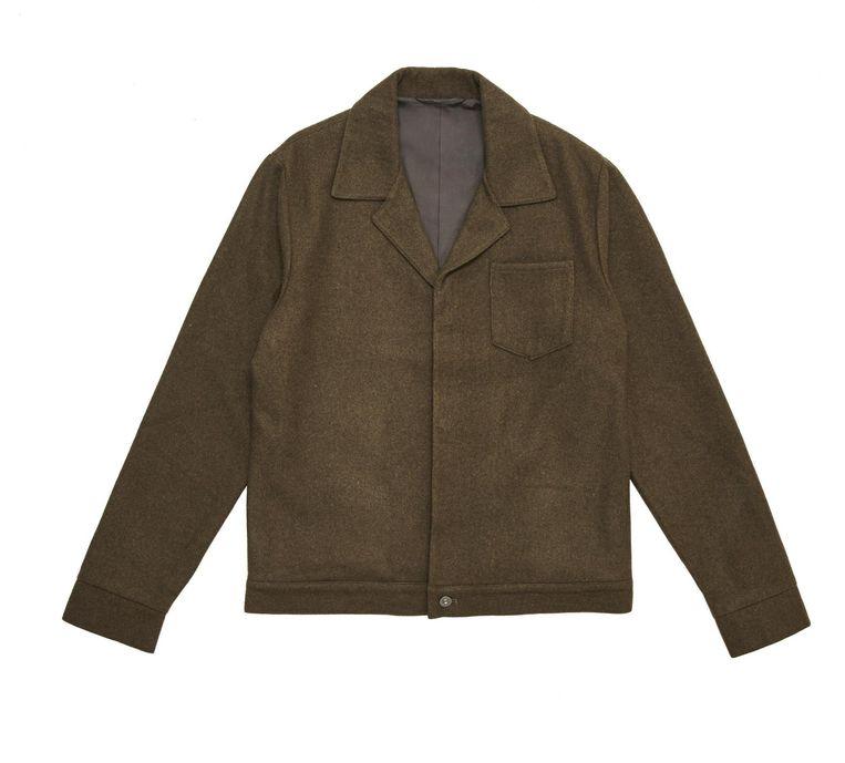 Bruin wollen jasje van Asos, 70 euro. Beeld .