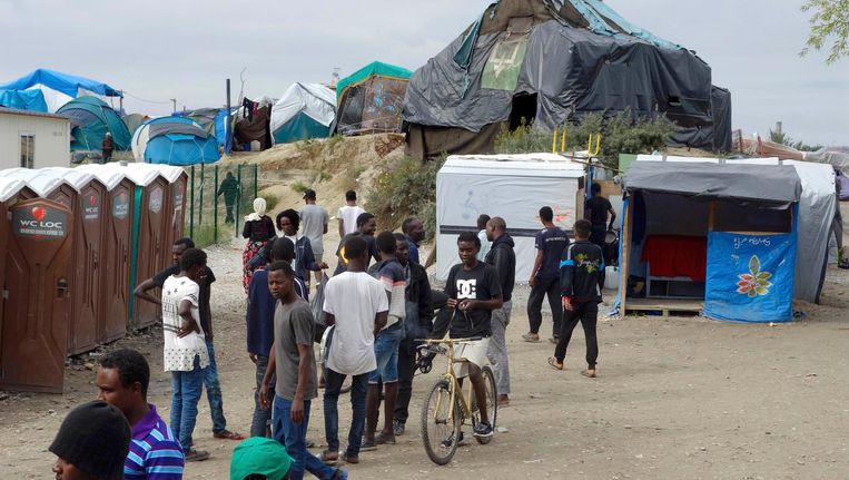 Het vluchtelingenkamp bij Calais. Beeld Reuters