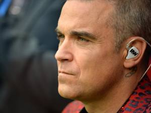 Robbie Williams déclare la guerre à Liam Gallagher