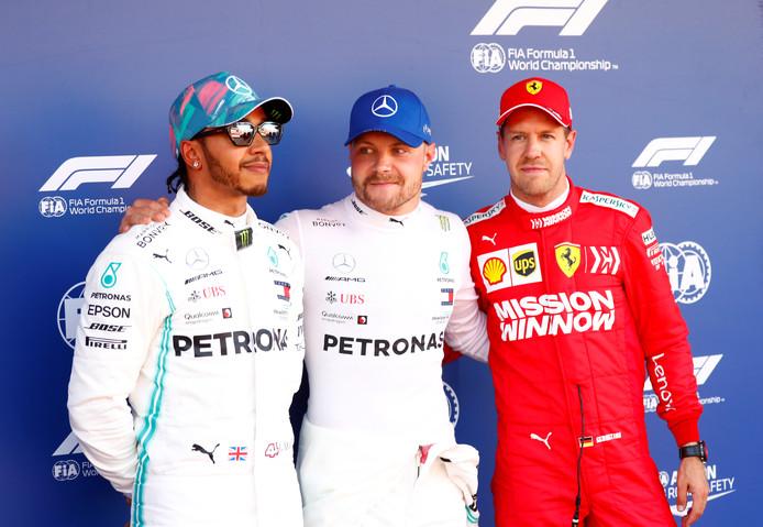 Het podium van de kwalificatie. Bottas geflankeerd door Hamilton en Vettel.