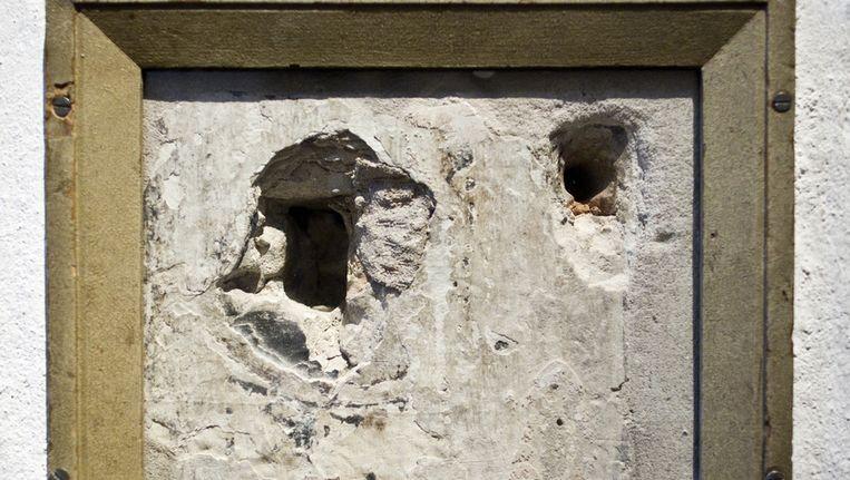wee kogelgaten in de muur in Het Prinsenhof in Delft waar Willem van Oranje werd doodgeschoten. Beeld ANP