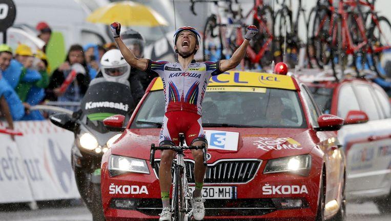 Joaquim Rodriguez op de finish in Plateau de Beille Beeld anp