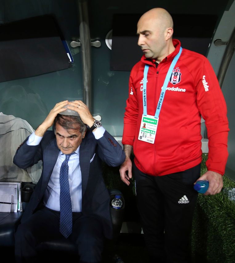 Besiktas coach Senol Gunes puts ice on his head after he suffered a head injury from an object, during the Turkish Cup semi-final second leg match between Besiktas and Fenerbahce in Istanbul, Thursday, April 19, 2018. The Turkish Cup semifinal between Fenerbahce and Besiktas was abandoned on Thursday after visiting coach Senol Gunes was injured by an object thrown from the stands. (AP Photo)