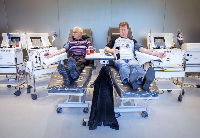 Doneren bij Sanquin in Amsterdam. Beeld Raymond Rutting/de Volkskrant