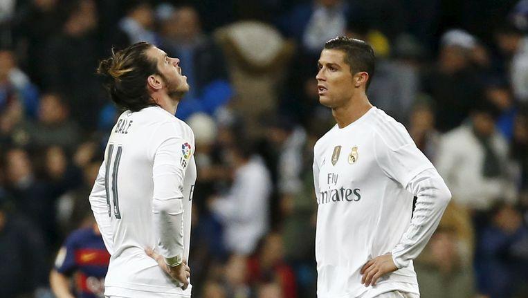 Gareth Bale en Cristiano Ronaldo balen. Beeld reuters