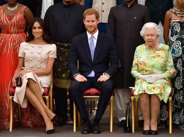 Queen Elizabeth met haar kleinzoon Harry en diens Meghan.