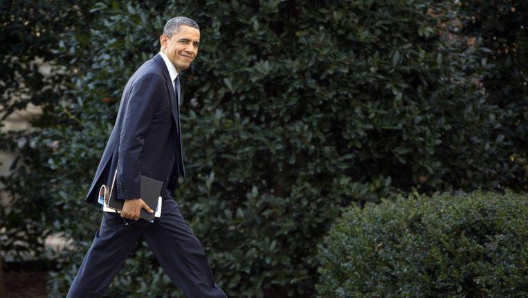 President Barack Obama op weg naar de Oval Office. Beeld ap
