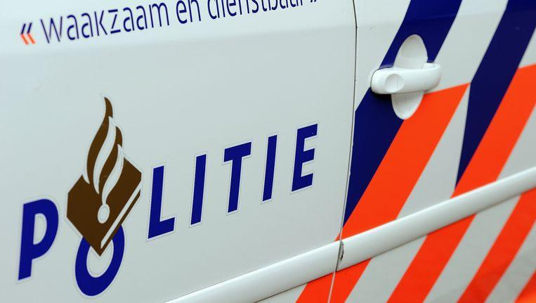De politie is op zoek naar twee mannen die een schoenenzaak hebben overvallen in de Kinkerstraat. Beeld ANP