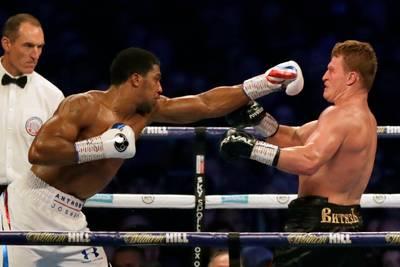 Joshua behoudt wereldtitels na knock-out tegen Povetkin