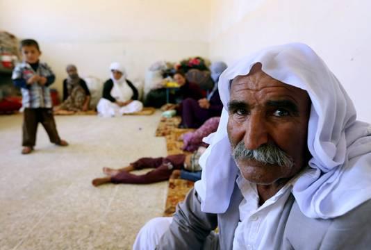 Een Yezidi familie uit Irak vluchtte naar de Koerdische stad Dohuk.