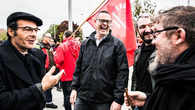 Raoul Hedebouw (tweede van links) bij een staking in Luik. Beeld Aurélie Geurts