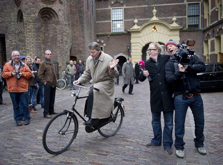 Piet Hein Donner op de fiets. Beeld ANP