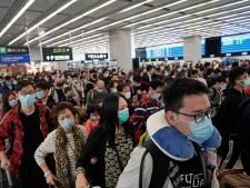 """Virus: une deuxième ville de Chine en quarantaine, """"alerte elevée"""" à Hong Kong"""