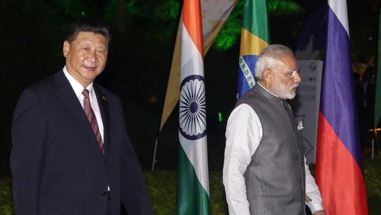 Chinese president Jinping en de Indiase premier Modi in 2016, tijdens een BRICS top in 2016 Beeld epa
