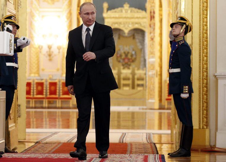 Guus Hiddink was in 2008 bondscoach van Rusland en Dick Advocaat liet zich tien jaar geleden door Poetin (foto) persoonlijk benaderen voor een nieuw contract als coach bij Zenit St.-Petersburg. Beeld EPA
