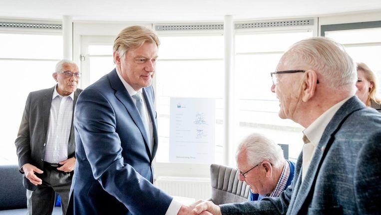 Staatssecretaris Martin van Rijn tijdens een werkbezoek. Beeld anp