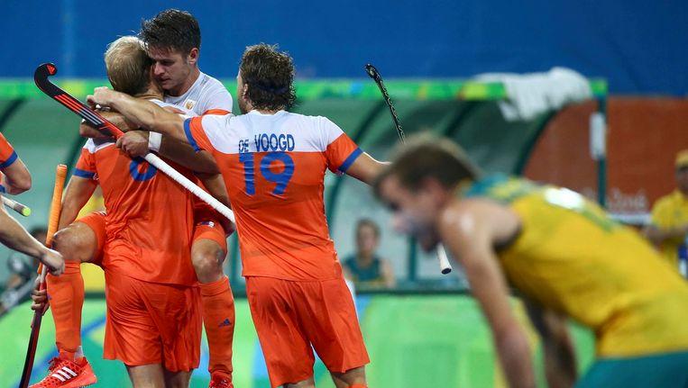 Blijdschap bij de Nederlandse hockeyers. Beeld Photo News
