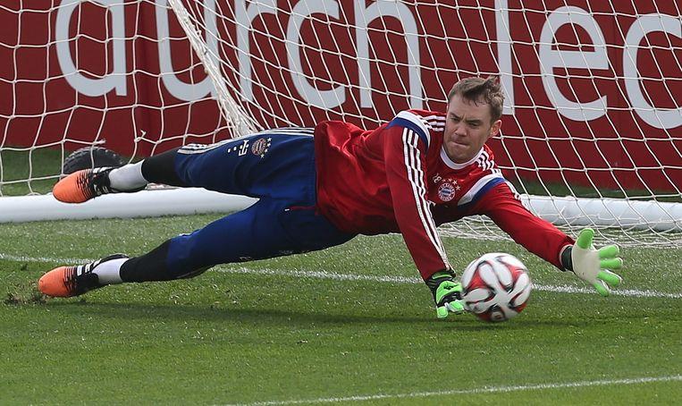 Manuel Neuer tijdens een training in München. Beeld afp