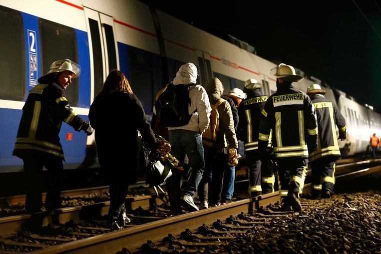 Rescue personnel are seen at the site of train crash in Meerbusch, Germany December 5, 2017. REUTERS/Thilo Schmuelgen