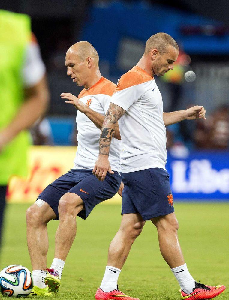 Arjen Robben en Wesley Sneijder tijdens de training. Beeld anp