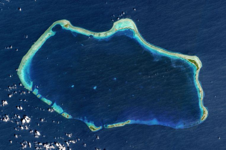 Satellietbeeld van het atol Bikini, een van de Marshalleilanden. De Marshalleilanden bestaan uit 29atollen, ringvormige eilandenreeksen, die samen 1.200 eilandjes omvatten. Beeld GettyImages