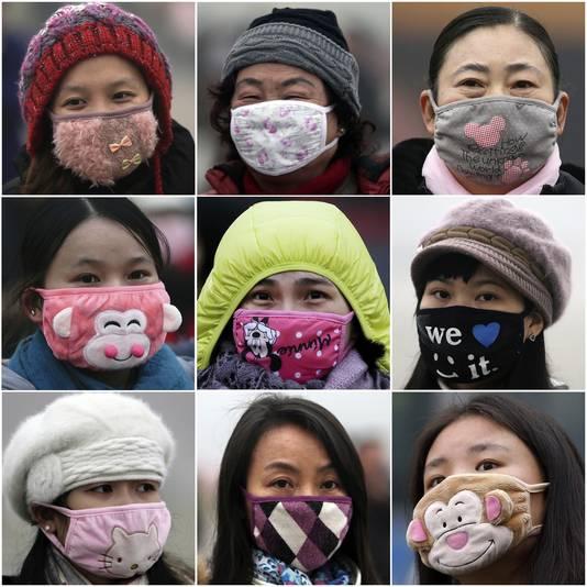 Chinezen dragen maskers tegen de luchtvervuiling