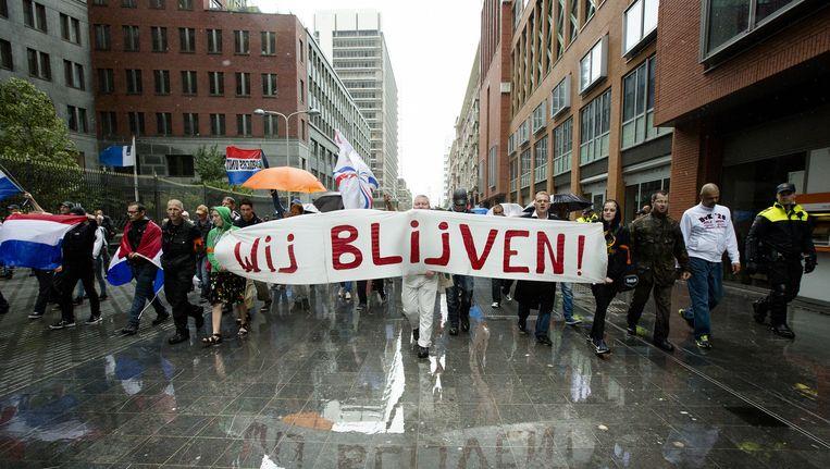 Demonstranten tijdens de 'Mars van de vrijheid' tegen moslimradicalen en anti-semitisme op 10 augustus. Beeld anp