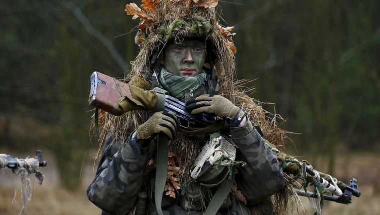 Pools lid van een patriottische schietvereniging op oefening. Beeld reuters
