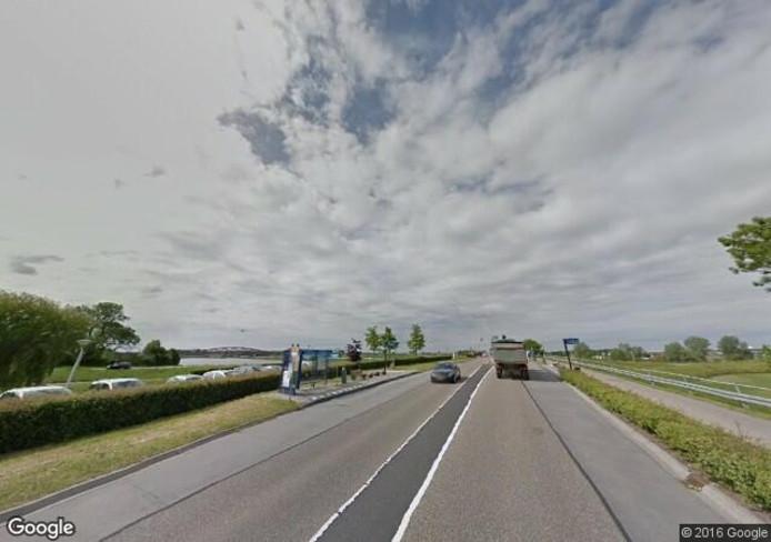De Spoolderbergweg, waar Pieter op de bus stond te wachten. Foto: Google Streetview