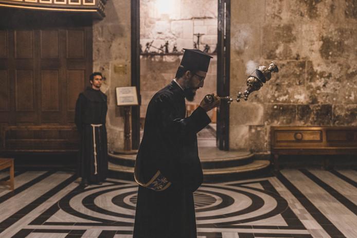 Een Russisch orthodoxe priester. De geestelijken op de foto hebben niets met de genoemde doop te maken.