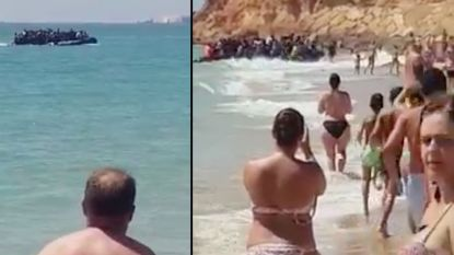 VIDEO. Vluchtelingen varen naar drukbezocht Spaans strand, en verdwijnen tussen de rotsen