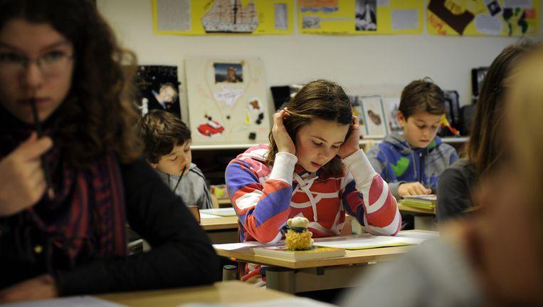 Leerlingen in Amsterdam maken de Citotoets. Beeld anp