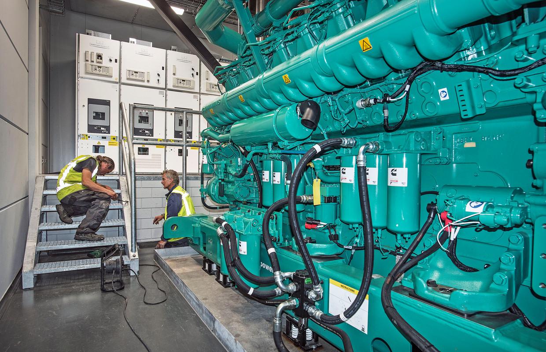 Generatoren van het databedrijf Equinix dienen als back-up voor de stroomvoorziening. Maandag faalden de back-upsystemen van 112. Equinix heeft overigens niets met deze storing te maken. Beeld de Volkskrant / Guus Dubbelman