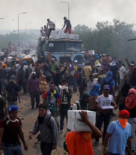 Doden en gewonden bij grens Venezuela, vrachtwagens hulpkonvooi in brand gestoken