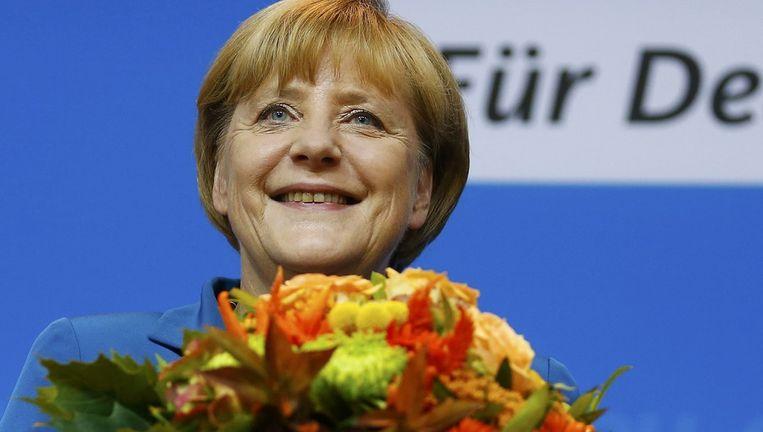 Een blije Angela Merkel Beeld reuters