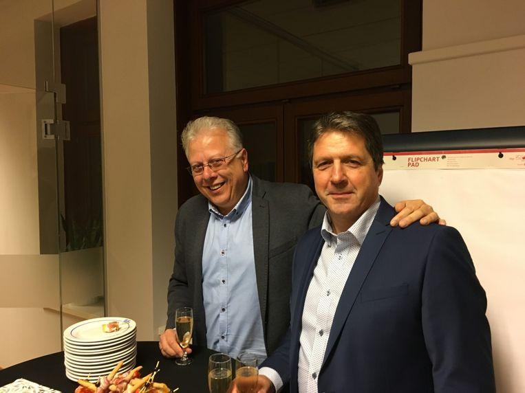 De oude en nieuwe voorzitter, Patrick Van Kerckhove en Guido Van Reet.