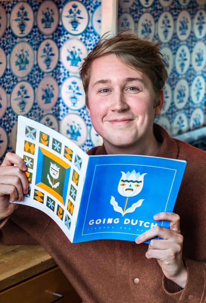 De in New York wonende Illustrator Clemens den Exter met zijn boek Going Dutch.