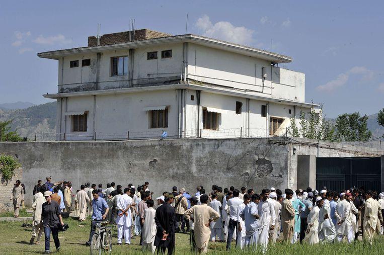 Het complex in Abbottabad in Pakistan, waar Osama bin Laden zich schuilhield en uiteindelijk werd gedood. Bij de actie zette Amerikaanse special forces ook een hond in (zoals de foto hieronder). Beeld afp